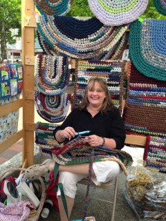 women and her handmade rag rugs
