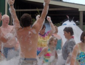 group of people dancing in a mountain of bubbles