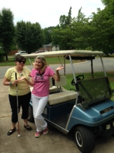 Suzanne and me with my golf cart